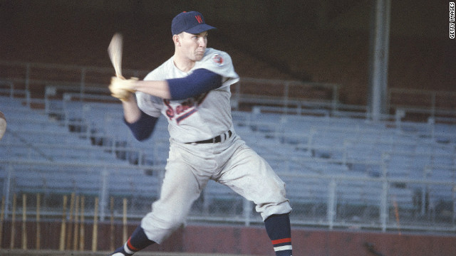 Harmon Killebrew, wearing his Washington Senators uniform, swings a bat during practice, c. 1957.