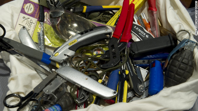 Knives, scissors and other banned items recovered at airport security checkpoints by the TSA.