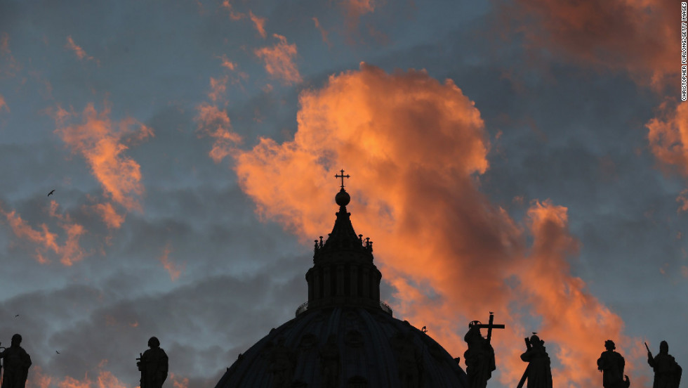 The sun sets over St Peter's Basilica as cardinals prepare to vote for a new pope on March 9.