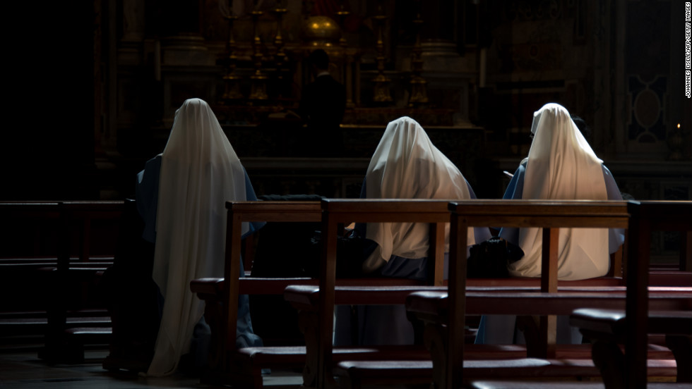 Nuns pray inside St. Peter's Basilica on March 10.