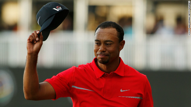 Tiger Woods celebrates after his two-stroke victory at the World Golf Championships on March 10, 2013.