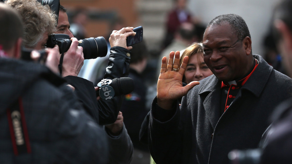 Nigerian Cardinal John Onaiyekan is surrounded by media on March 11 as he leaves the final congregation before cardinals enter the conclave to vote for a new pope.