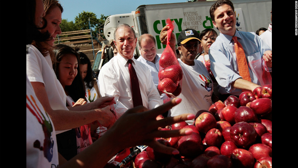 Bloomberg joins volunteers to bag apples for poor families as part of a Mandela Day event in July 2009. Mandela Day is a celebration of Nelson Mandela's life and legacy. It encourages good works and volunteerism around the world.