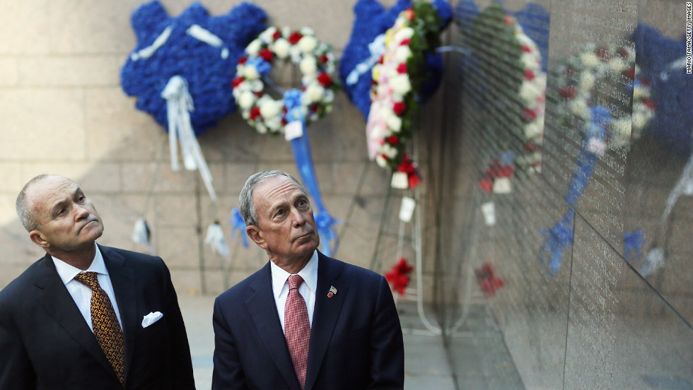 Bloomberg and New York Police Commissioner Ray Kelly look at the New York Memorial Wall during an unveiling in October 2012.  The city added the names of 15 officers who died the previous year.