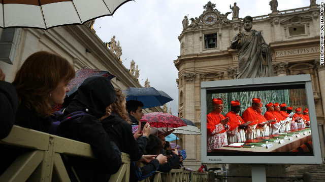 VATICAN CITY, VATICAN - MARCH 12: Pilgrims in St Peter's Square watch a giant television screen showing a mass being held in the basilica on March 12, 2013 in Vatican City, Vatican. Pope Benedict XVI's successor is being chosen by the College of Cardinals in Conclave in the Sistine Chapel. The 115 cardinal-electors, meeting in strict secrecy, will need to reach a two-thirds-plus-one vote majority to elect the 266th Pontiff. (Photo by Peter Macdiarmid/Getty Images)
