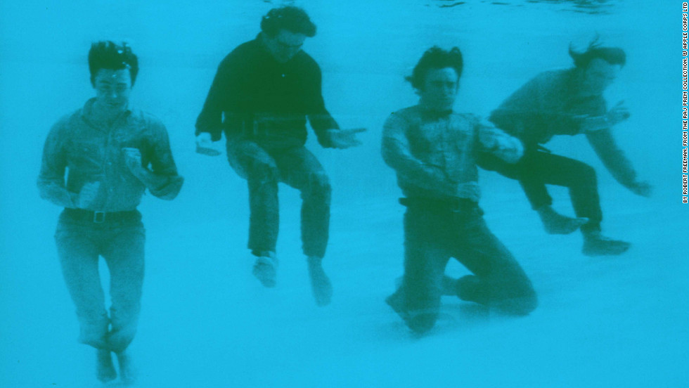 "The Beatles pose fully-dressed underwater in the pool of the Nassau Beach Hotel in the Bahamas where they were filming their comedy movie ""Help!"" Freeman was with them on set."