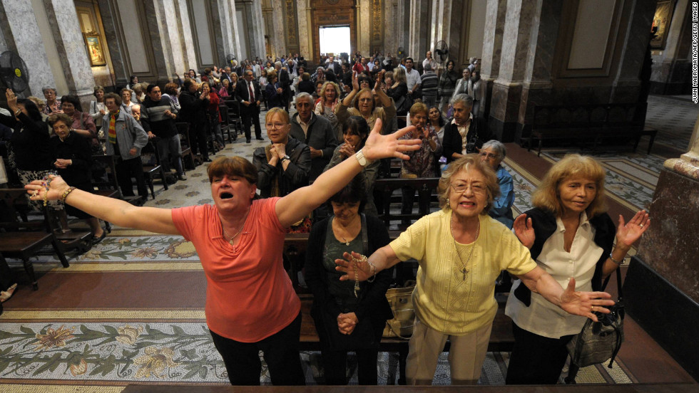 Argentinians celebrate after the announcement that former Buenos Aires Archbishop Jorge Mario Bergoglio was elected pope at the Metropolitan Cathedral in Buenos Aires.