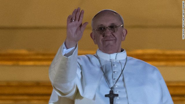 Argentina's Jorge Bergoglio, elected Pope Francis I waves from the window of St Peter's Basilica's balcony after being elected the 266th pope of the Roman Catholic Church on March 13, 2013 at the Vatican.