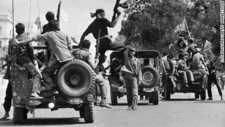 Khmer Rouge forces drive through Phnom Penh on 17 April, 1975.