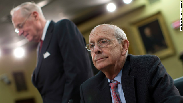 Supreme Court Associate Justices Anthony Kennedy (L) and Stephen Breyer await the start of a hearing on Capitol Hill March 14, 2013 in Washington, DC.
