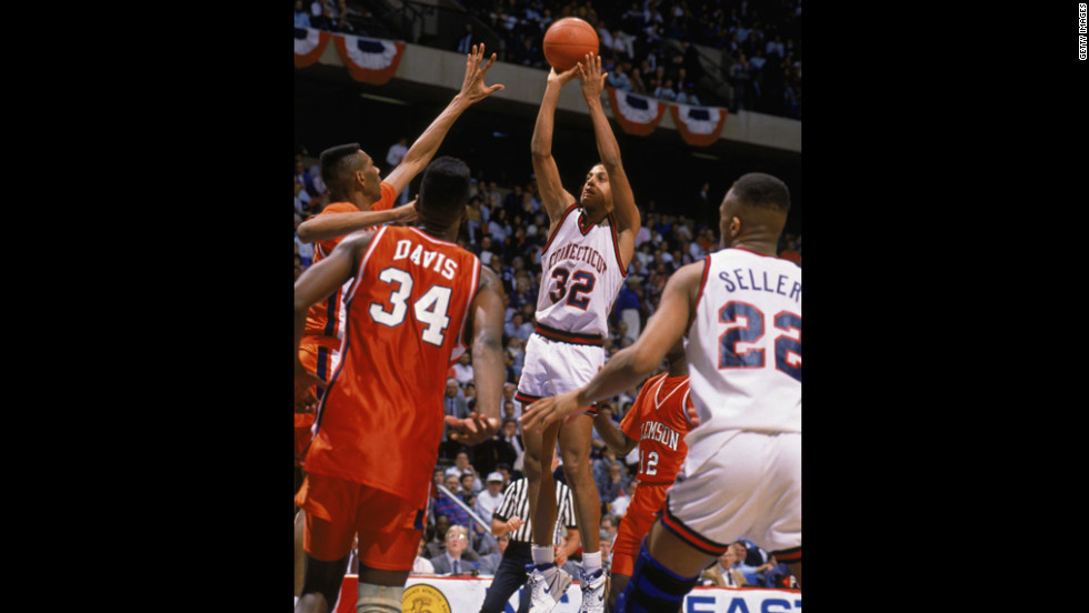 Tate George of the UConn Huskies sinks the game-winning shot at the buzzer to beat Clemson 71-70 on March 22, 1990, in East Rutherford, New Jersey, moving them to the Elite Eight for the first time since 1964.