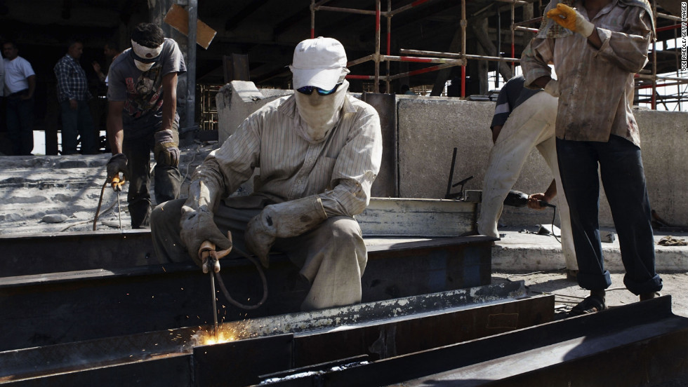 Construction workers weld beams at the Ministry of Transportation building in Baghdad on July 21, 2004. The building was being rebuilt after it was gutted by a fire.