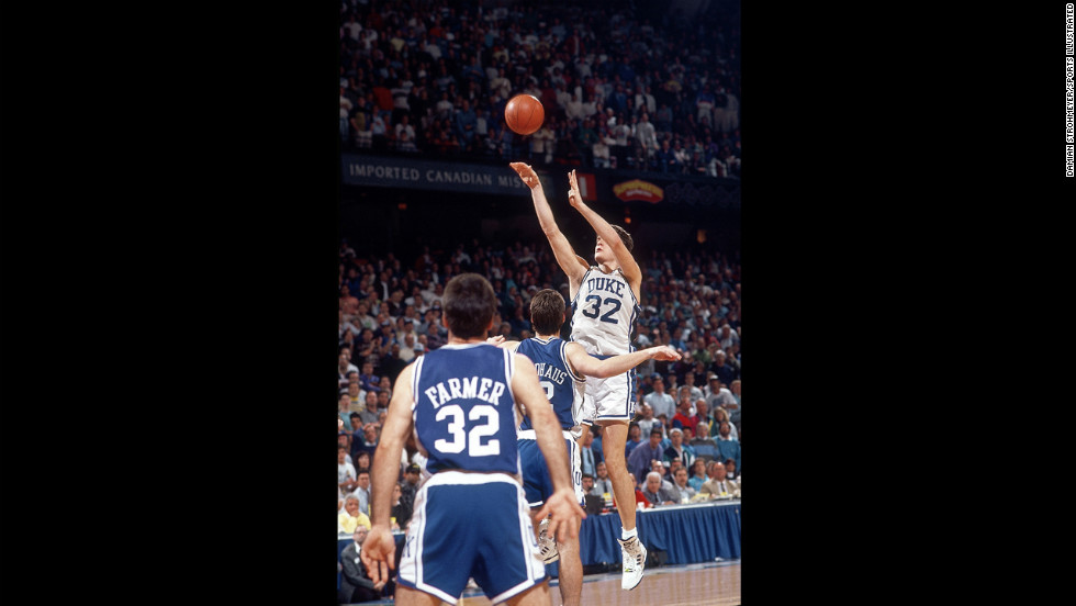 Christian Laettner of Duke University shoots the game-winning shot with 2.1 seconds remaining to beat Kentucky 104-103 in overtime during the tournament on March 28, 1992, in Philadelphia.
