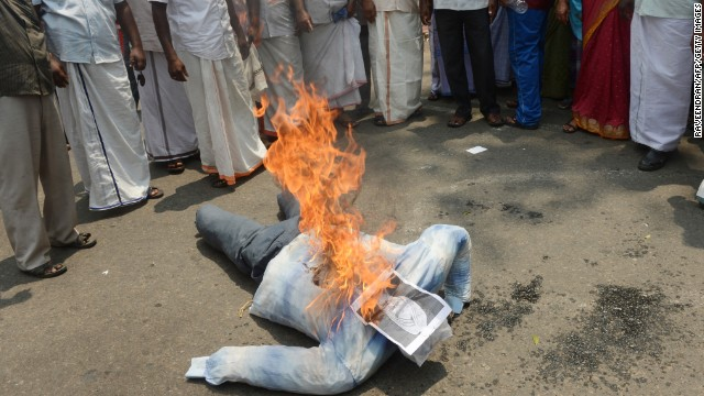 Indian fishermen burn an effigy of Prime Minister Manmohan Singh in Trivandrum, Kerala, on March 13, 2013.