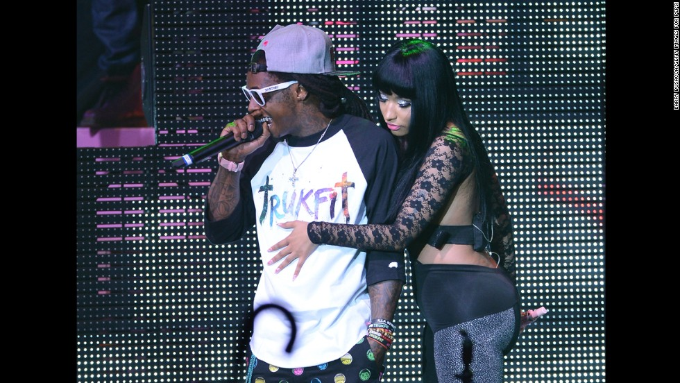Lil Wayne and Nicki Minaj perform during Minaj's Pink Friday Tour at Roseland in New York on August 14, 2012,