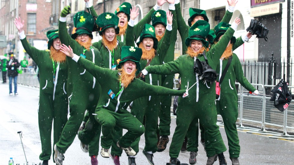 Revelers dressed as leprechauns cheer during the St. Patrick's Day festivities in Dublin, Ireland, on Sunday, March 17.
