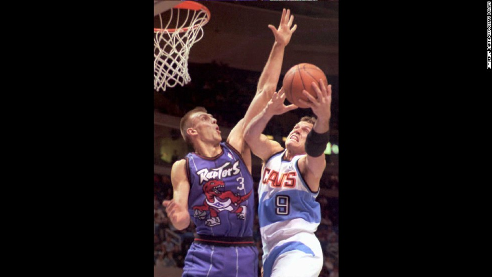 "A purple dinosaur can never be intimidating -- and this came three years after ""Barney & Friends"" first aired. The Toronto Raptors' Zan Tabak shows his claws against the Cleveland Cavaliers' Dan Majerle in November 1995."