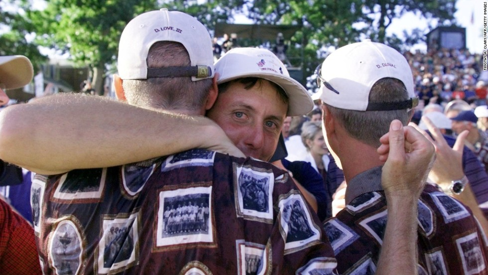 The U.S team wanted the 1999 Ryder Cup to be a match for the photo albums, so it made the uniforms into one. The Europeans never stood a chance. Phil Mickelson hugs teammates Davis Love III, left, and David Duval after winning the cup.
