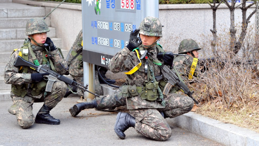 South Korean soldiers take part in a drill to guard the building of a state-run telecom company in Seoul against potential guerrilla attacks on Thursday, March 14.