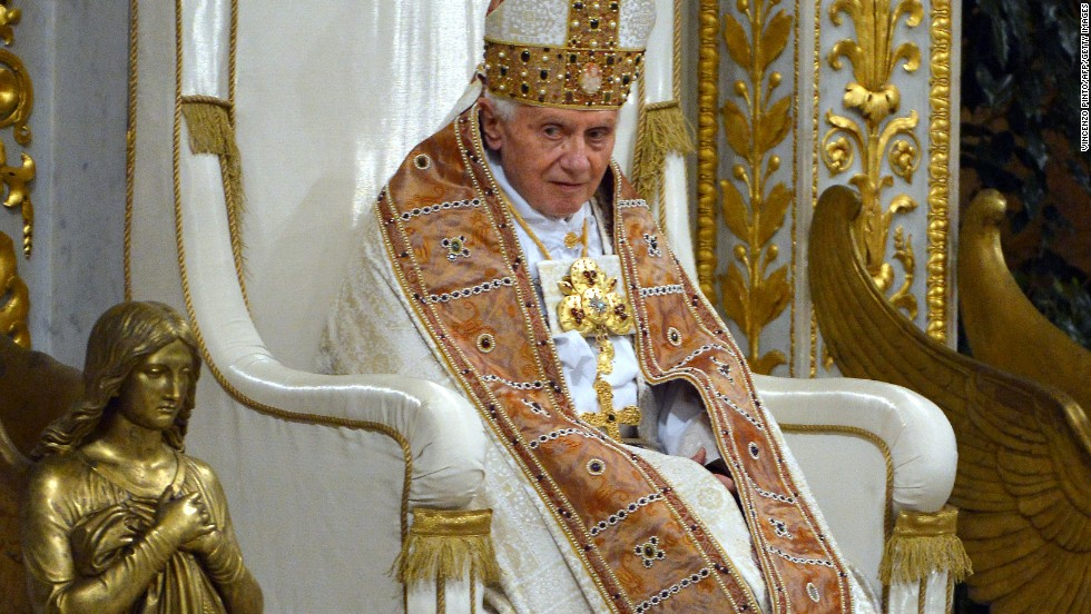 "The mantum is a long cape that popes sometimes wear as a sign of their authority, Beck said. It's a vestment that fell out of use, but was revived by Benedict XVI, seen here. The mitre, Beck said, is a cone-like head dress worn by all bishops as a sign of their episcopacy. ""Abbots can also wear it,"" Beck said. ""It is not unique to the pope, but it replaced the tiara on the Papal Coat of Arms with Benedict, and now Francis."""