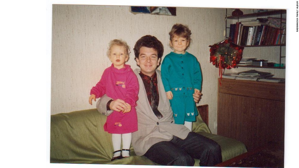 A young Urszula (left) and Agnieszka pose at home with their father Robert, a veteran tennis coach who has been their mentor.