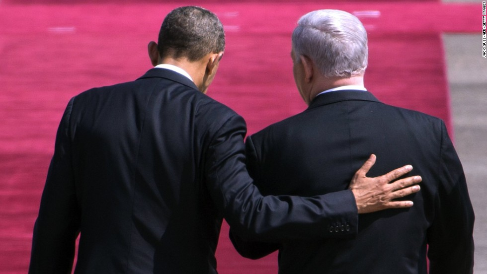 Israeli Prime Minister Benjamin Netanyahu greets Obama at Israel's Ben Gurion Airport on March 20.