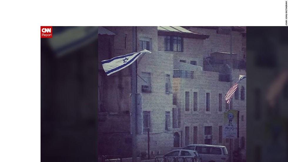 "Israeli and U.S. flags flying side-by-side can be seen all across Jerusalem with banners boasting of the ""unbreakable alliance"" with the United States."