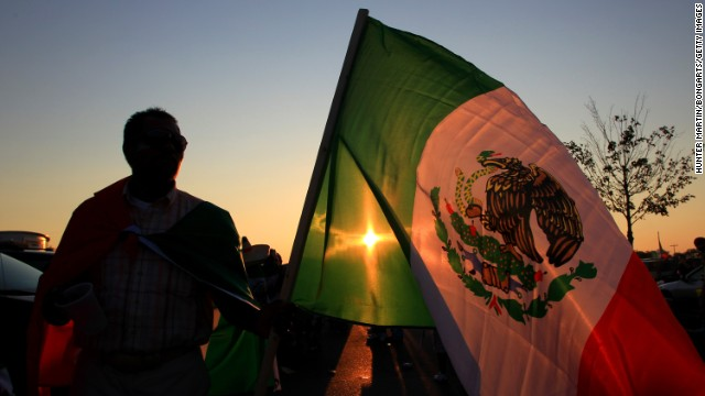 PHILADELPHIA, PA - AUGUST 10: A fan waves the flag of Mexico in the parking lot before a game between Mexico and the United States at Lincoln Financial Field on August 10, 2011 in Philadelphia, Pennsylvania. The game ended 1-1. (Photo by Hunter Martin/Bongarts/Getty Images)