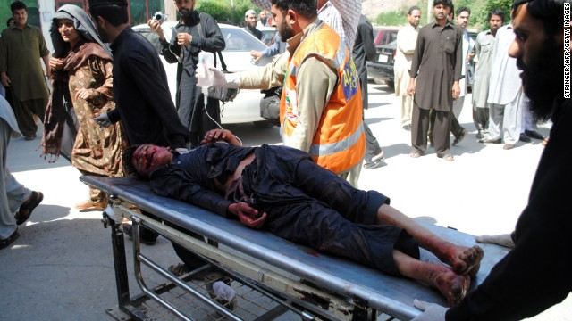 A blast victim is taken to a hospital following a car bomb blast at a refugee camp in Pakistan on Thursday.