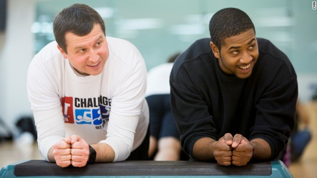 Douglas Mogle, left, and Will Cleveland do a plank during the Fit Nation kick-off weekend.