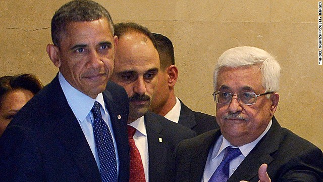 Palestinian president Mahmud Abbas (R) and US President Barack Obama (L) arrive for a joint press conference at the Muqataa, the Palestinian Authority headquarters, in the West Bank city of Ramallah on March 21, 2013. Obama arrived in the West Bank to a more prickly welcome from Palestinian leaders than the warm embrace he won in Israel the day before. AFP PHOTO/MANDEL NGAN (Photo credit should read MANDEL NGAN/AFP/Getty Images)