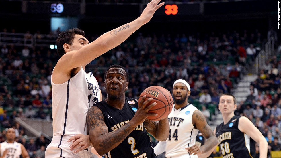 Malcolm Armstead of the Wichita State Shockers drives on Steven Adams of the Pittsburgh Panthers on March 21 in Salt Lake City, Utah.