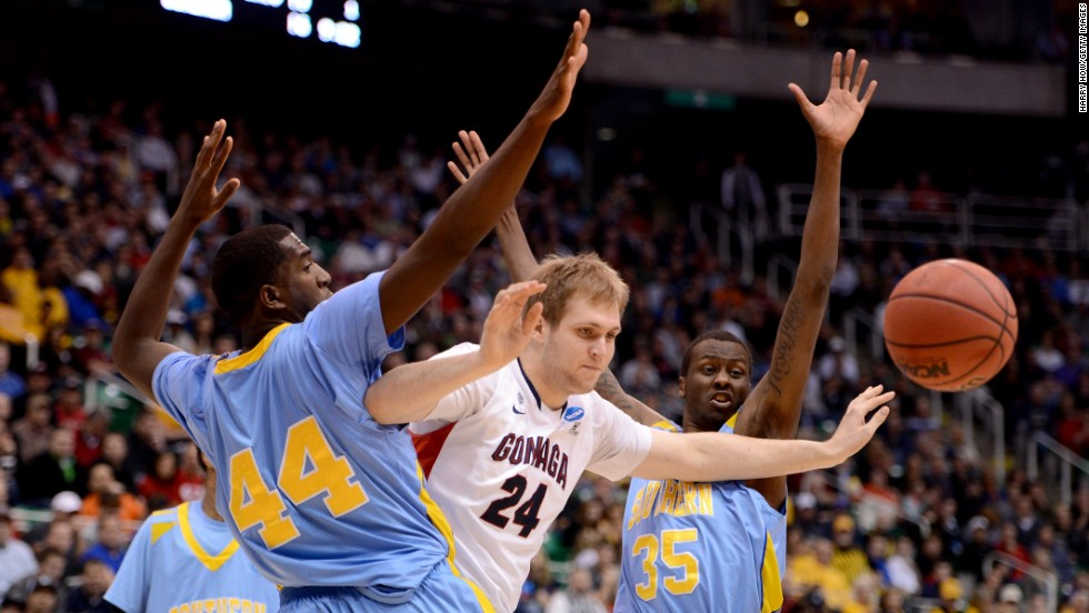 Przemek Karnowski of the Gonzaga Bulldogs, center, loses the ball between Javan Mitchell, left, and Madut Bol of the Southern University Jaguars on March 21 in Salt Lake City, Utah.