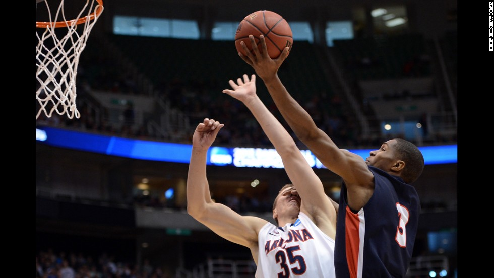 Kerron Johnson of the Belmont Bruins tries for a lay-up over Kaleb Tarczewski of the Arizona Wildcats on March 21 in Salt Lake City, Utah.