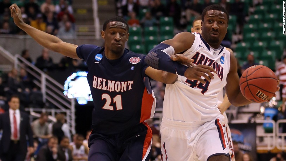 Solomon Hill of the Arizona Wildcats drives on Ian Clark of the Belmont Bruins on March 21.