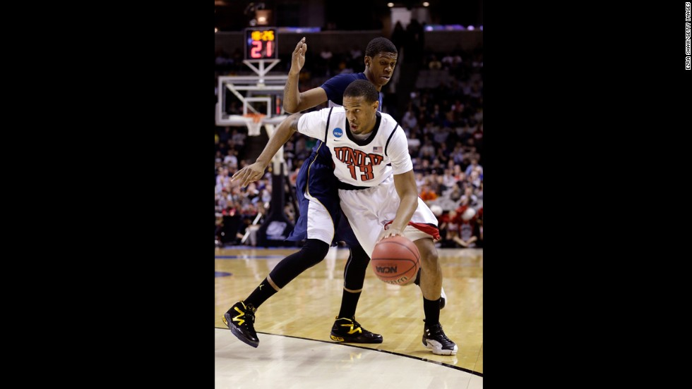 Bryce Dejean-Jones of UNLV drives past Tyrone Wallace of California on March 21.
