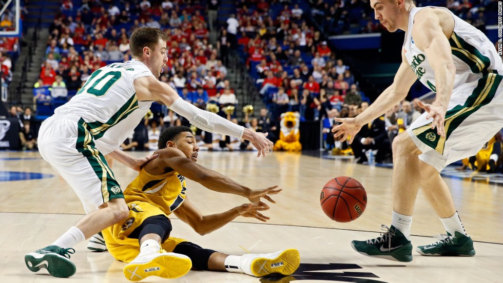 Phil Pressey of the Missouri Tigers tries to pass the ball away against Pierce Hornung and Wes Eikmeier of the Colorado State Rams on March 21 in Lexington, Kentucky.