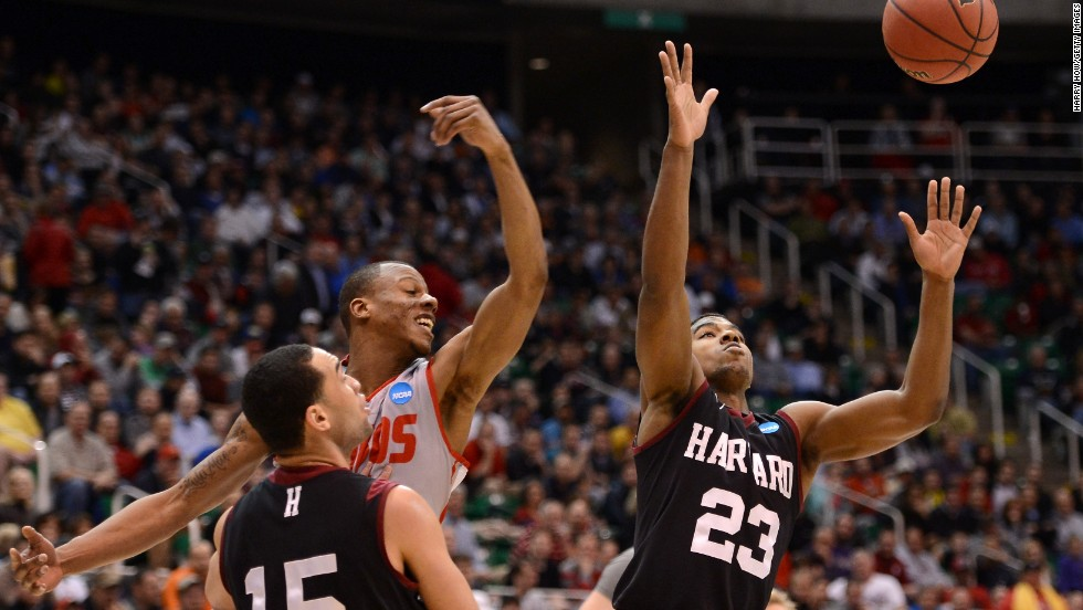 Wesley Saunders of the Harvard Crimson goes for the loose ball against Chad Adams of the New Mexico Lobos on March 21 in Salt Lake City, Utah.