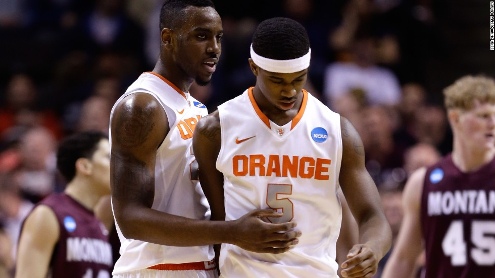 Rakeem Christmas, left, and C.J. Fair of Syracuse react after Fair's dunk against the Montana Grizzlies on March 21.