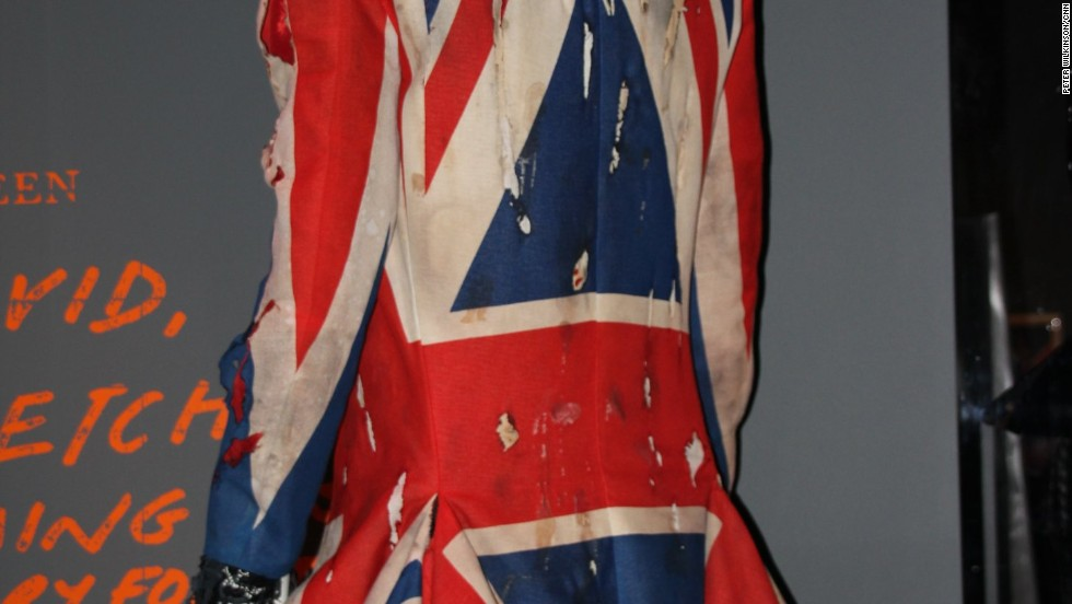 "Bowie wears this Union Jack coat he co-designed with Alexander McQueen -- then a relatively unknown designer -- for the ""Earthling"" album of 1997. He faces away from the camera in the photo, in contrast to all his other album covers, although his Ziggy-style haircut is still recognizable."