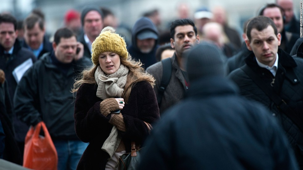 Cold weather keeps Britons bundled up as they cross the London Bridge on March 22.