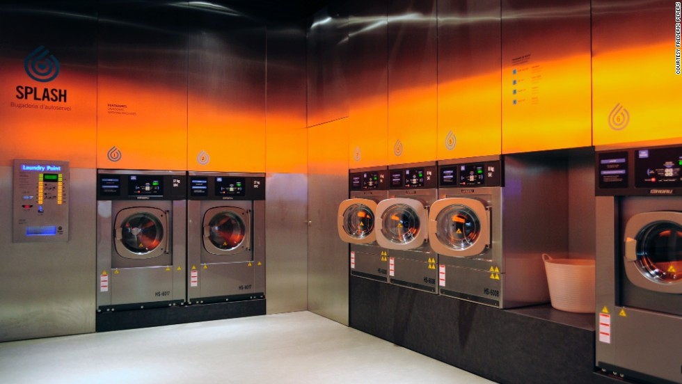 "What do you get when you cross being fresh with even fresher?  A laundromat that looks like a club! Splash, a chain of self-service laundromats in Spain, are a far cry from your average dingy neighborhood washhouse. <a href=""http://www.fredericperers.cat/"" target=""_blank"">According to designer Frederic Perers</a>, the eco-friendly cleaning center features steel surfaces that reflect orange tones on the opposite wall, serving as a ""warm counterelement to the coldness of the metal."" But will a club-like atmosphere really attract a younger clientele?"