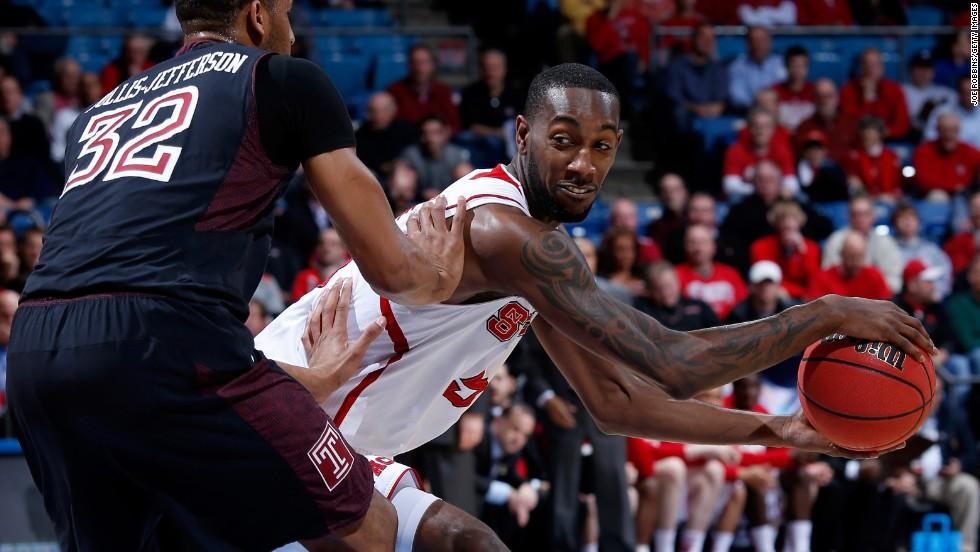 C.J. Leslie of the North Carolina State Wolfpack, right, looks to pass against Rahlir Hollis-Jefferson of the Temple Owls on March 22.