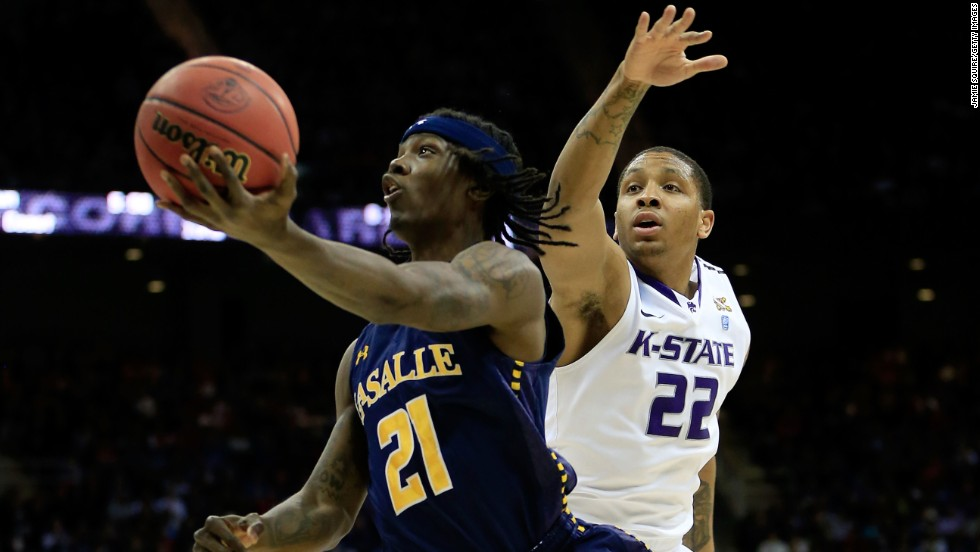 Tyrone Garland of the La Salle Explorers, left, shoots against Rodney McGruder of the Kansas State Wildcats on March 22 in Kansas City, Missouri.