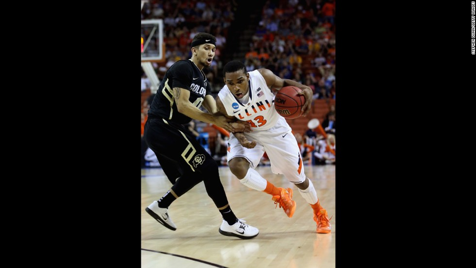Tracy Abrams of the Illinois Fighting Illini, right, drives past Askia Booker of the Colorado Buffaloes on March 22.