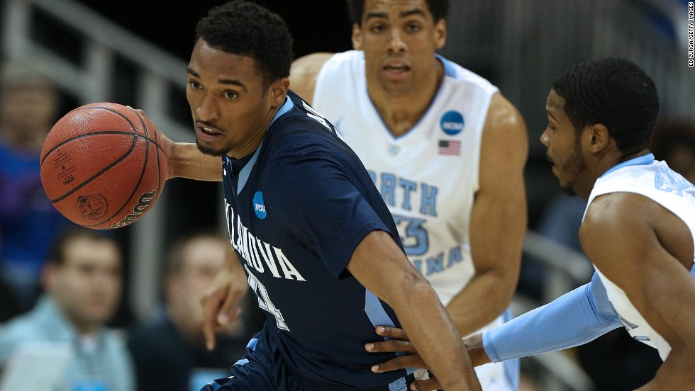 Darrun Hilliard of the Villanova Wildcats, left, drives against Dexter Strickland of the North Carolina Tar Heels on March 22 in Kansas City, Missouri.