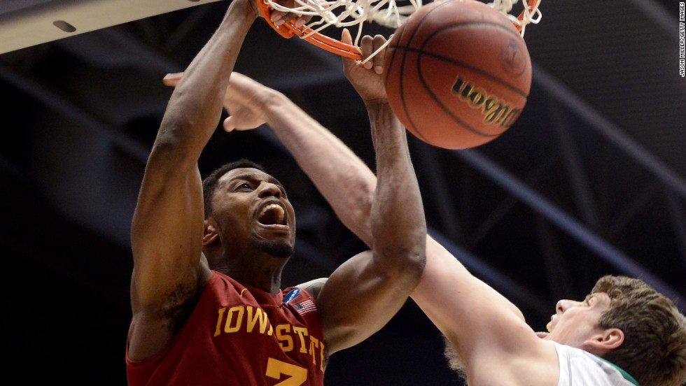 Melvin Ejim of the Iowa State Cyclones, left, dunks against Tom Knight of the Notre Dame Fighting Irish on March 22 in Dayton, Ohio.