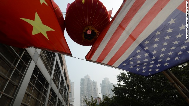 This photo taken on February 3, 2013 shows the US and Chinese flags flying outside an office building in the downtown area of Chongqing, China.