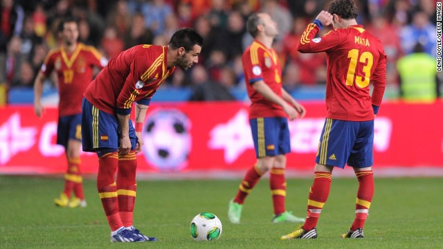 Spain's players show their disappointment after conceding a late equalizer at home to Finland in a World Cup qualifier in Gijon.