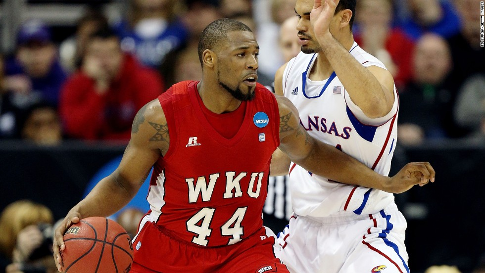 "George Fant of the Western Kentucky Hilltoppers, left, drives against Perry Ellis of the Kansas Jayhawks on Friday, March 22, in Kansas City, Missouri. Check back this weekend to follow the action during second round of the 2013 NCAA tournament, and <a href=""http://www.cnn.com/2013/03/19/worldsport/gallery/ncaa-tournament-first-round/index.html"">look back at the NCAA First Four</a>."